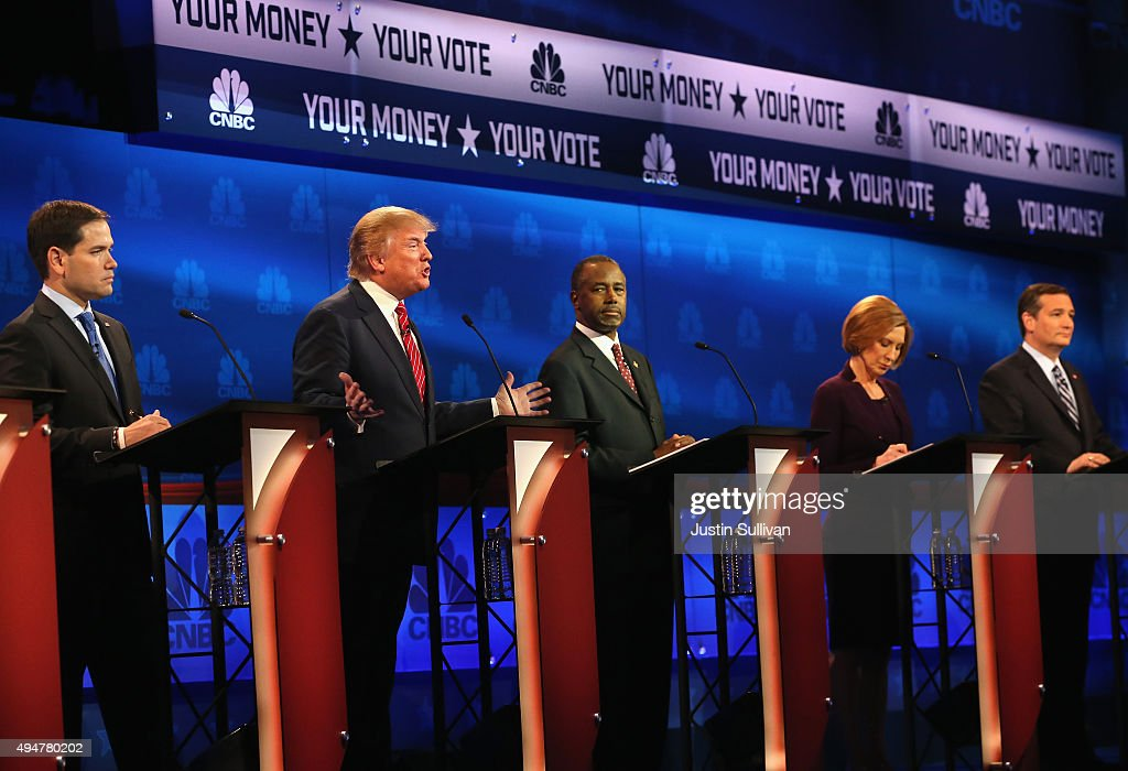 Presidential candidates Donald Trump speaks while Sen Marco Rubio Ben Carson Carly Fiorina Sen Ted Cruz look on during the CNBC Republican...