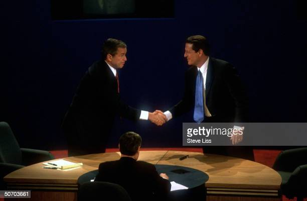 Presidential candidates Gov George W Bush VP Al Gore shaking hands at end of their second campaign debate at Wake Forest University