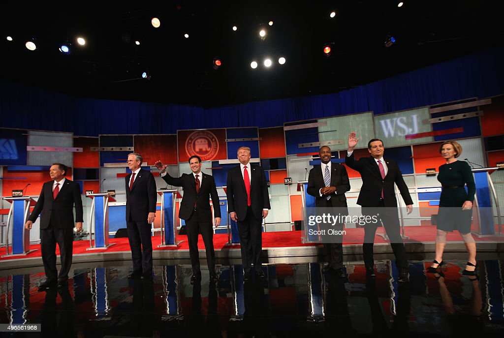 Presidential candidates Ohio Governor John Kasich (L-R), Jeb Bush, Sen. Marco Rubio (R-FL), Donald Trump, Ben Carson, Ted Cruz (R-TX), and Carly Fiorina take the stage in the Republican Presidential Debate sponsored by Fox Business and the Wall Street Journal at the Milwaukee Theatre November 10, 2015 in Milwaukee, Wisconsin. The fourth Republican debate is held in two parts, one main debate for the top eight candidates, and another for four other candidates lower in the current polls.