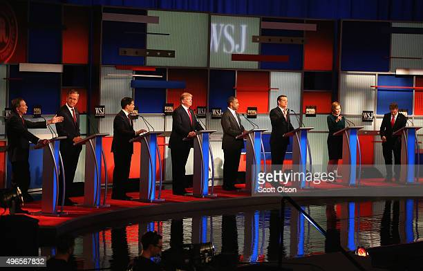 Presidential candidates Ohio Governor John Kasich speaks while Jeb Bush Sen Marco Rubio Donald Trump Ben Carson Ted Cruz Carly Fiorina and Sen Rand...