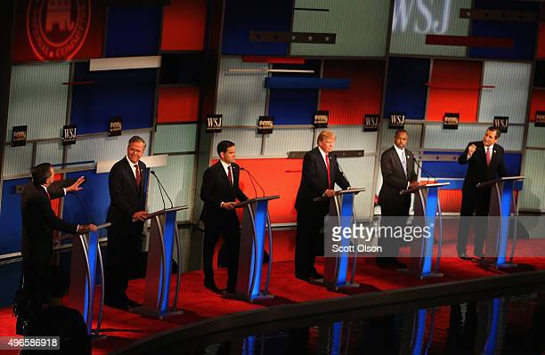 Presidential candidates Ohio Governor John Kasich speaks while Jeb Bush Sen Marco Rubio Donald Trump Ben Carson and Ted Cruz take part in the...