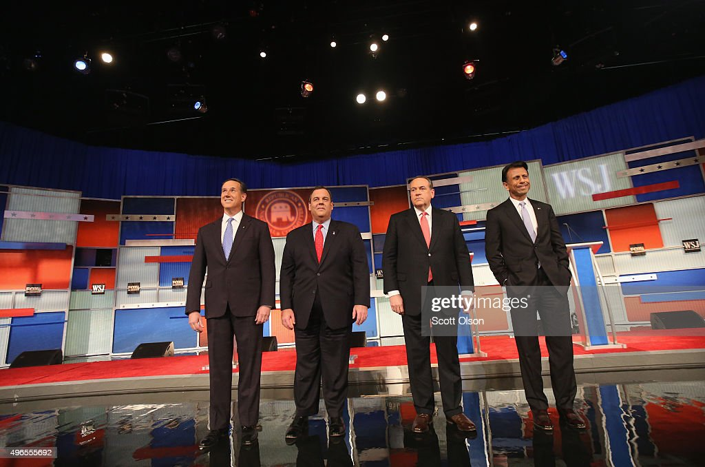 Presidential candidates Rick Santorum (L-R), New Jersey Governor Chris Christie, Mike Huckabee, and Louisiana Governor Bobby Jindal take the stage during the Republican Presidential Debate sponsored by Fox Business and the Wall Street Journal at the Milwaukee Theatre November 10, 2015 in Milwaukee, Wisconsin. The fourth Republican debate is held in two parts, one main debate for the top eight candidates, and another for four other candidates lower in the current polls.