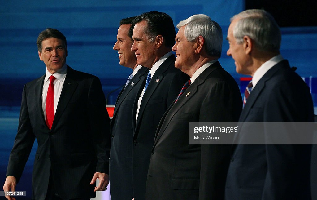 Presidential candidates (L-R) Texas Gov. Rick Perry, former U.S. Sen. Rick Santorum, former Massachusetts Gov. Mitt Romney, former Speaker of the House Newt Gingrich, and U.S. Rep. Ron Paul (R-TX) pose for a photos before participating in a Fox News, Wall Street Journal sponsored debate at the Myrtle Beach Convention Center, on January 16, 2012 in Myrtle Beach, South Carolina. Voters in South Carolina will head to the polls on January 21st. to vote in the Republican primary election to pick their choice for U.S. presidential candidate.