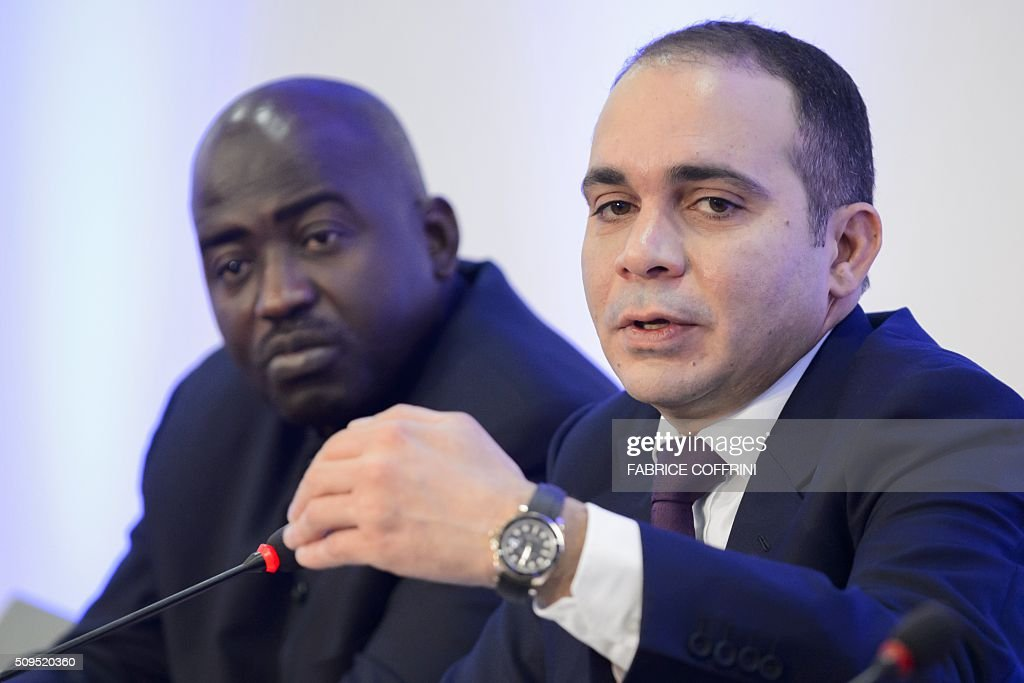 FIFA presidential contender Prince Ali bin al Hussein (R) gestures next to the president of the Liberia Football Association Musa Bility during a press conference on February 11, 2016 at the Geneva press club. The FIFA presidential election, when a successor to the disgraced Sepp Blatter will be voted in as the head of world football's governing body, will take place in Zurich on February 26. / AFP / FABRICE COFFRINI