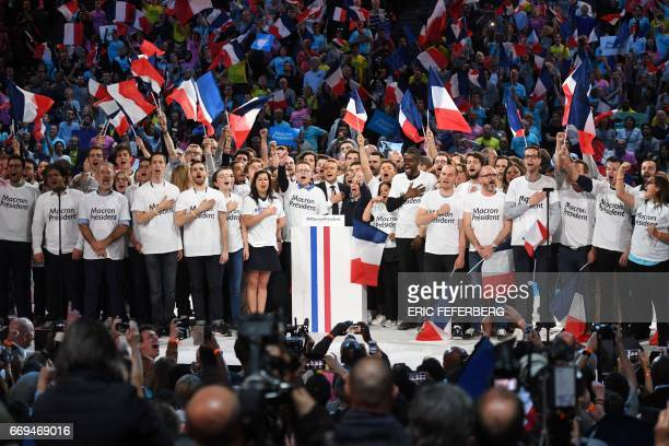 Presidential election candidate for the En Marche movement Emmanuel Macron sings the Marseillaise French national anthem on stage with his supporters...