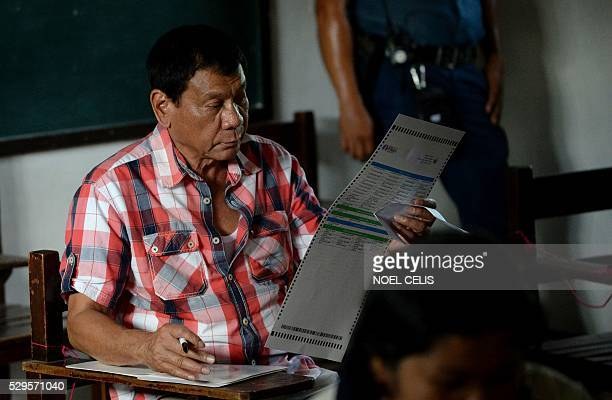 Presidential frontrunner and Davao City Mayor Rodrigo Duterte casts his vote at a voting precint at Daniel Aguinaldo National High School in Davao...