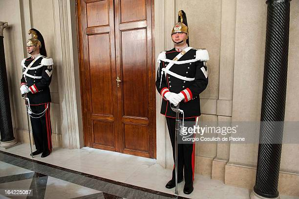 Presidential guards Corazzieri stand during the meeting between Italian President Giorgio Napolitano and the Italian parliament leaders at the...
