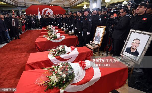 Presidential guards mourn around the coffins of their comrades who were killed in a bomb blast on a bus in central Tunis the previous day during a...