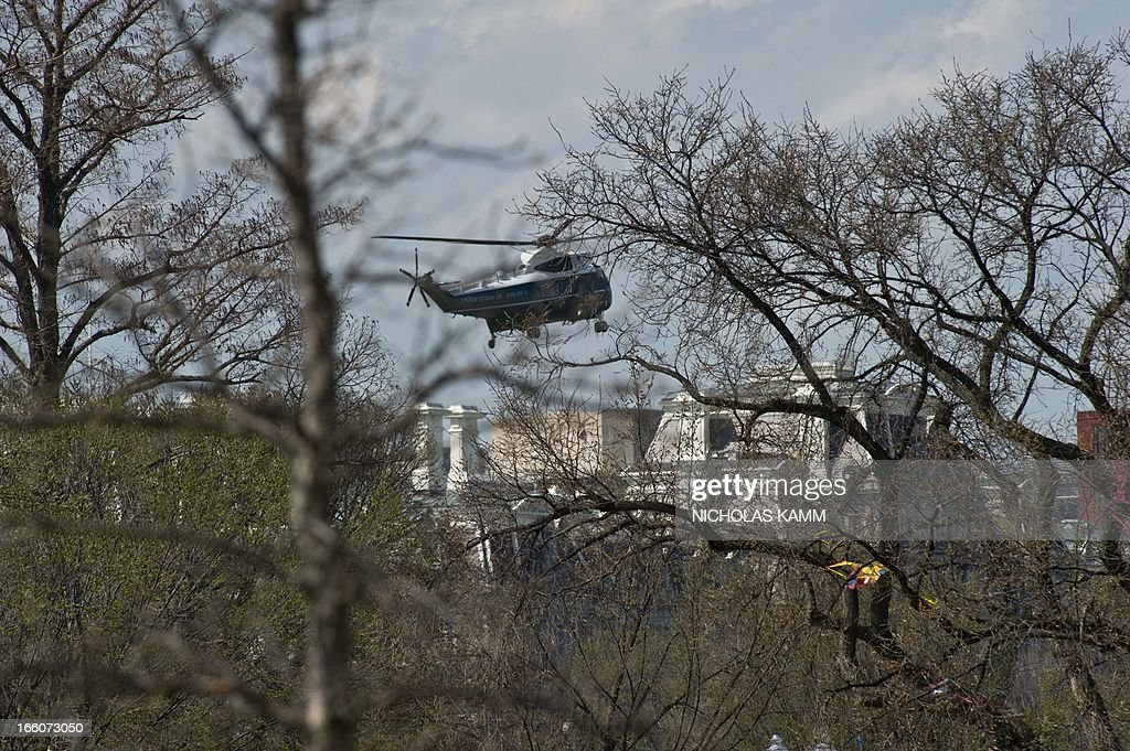 US presidential helicopter Marine One comes in to land at the White House in Washington on April 8, 2013 before President Barack Obama departs for Connecticut, not far from the site of the Newtown school massacre, in a bid to pressure Washington lawmakers into passing meaningful gun reform.AFP PHOTO/Nicholas KAMM