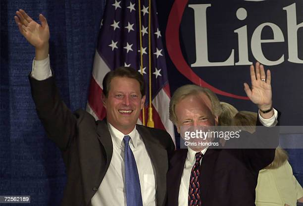 Presidential hopeful Al Gore waves with his running mate Joseph Lieberman at a rally August 9 in Lieberman's hometown of Stamford Ct