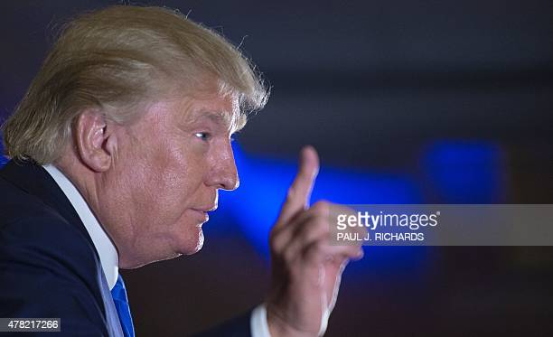 US presidential hopeful Donald Trump delivers remarks at the Maryland Republican Party's 25th Annual Red White Blue Dinner on June 23 2015 at the BWI...