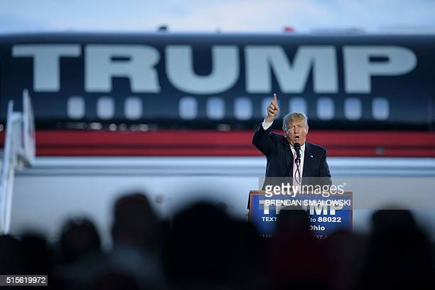 US presidential hopeful Donald Trump speaks during a rally March 14 2016 in Vienna Center Ohio The six remaining White House hopefuls made a frantic...