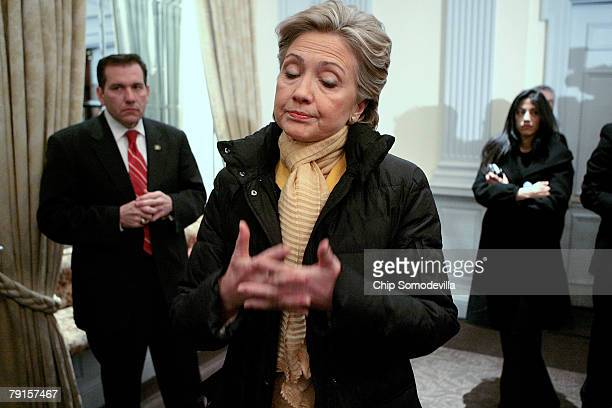 S Presidential hopeful Sen Hillary Clinton shrugs while taking with reporters about the economy and a possible bipartisan stimulus package after a...