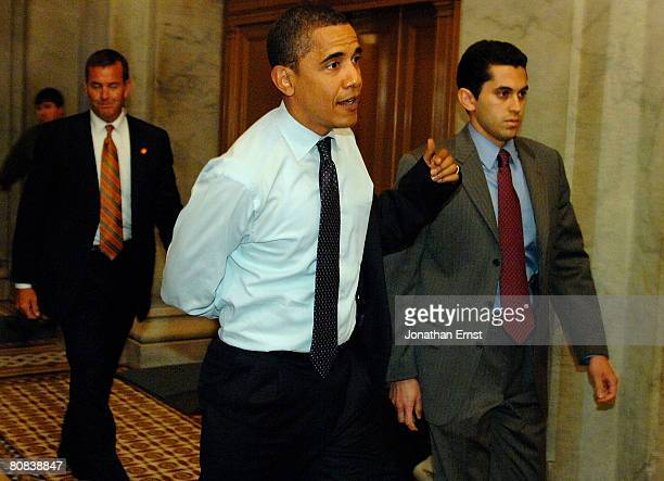 S presidential hopeful Senator Barack Obama arrives for a vote on an Equal Pay measure at the US Capitol April 23 2008 in Washington DC Although...