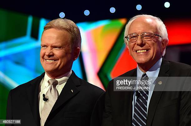 Presidential hopefuls Jim Webb and Bernie Sanders pose for photos on stage during the first Democratic presidential debate in Las Vegas Nevada on...