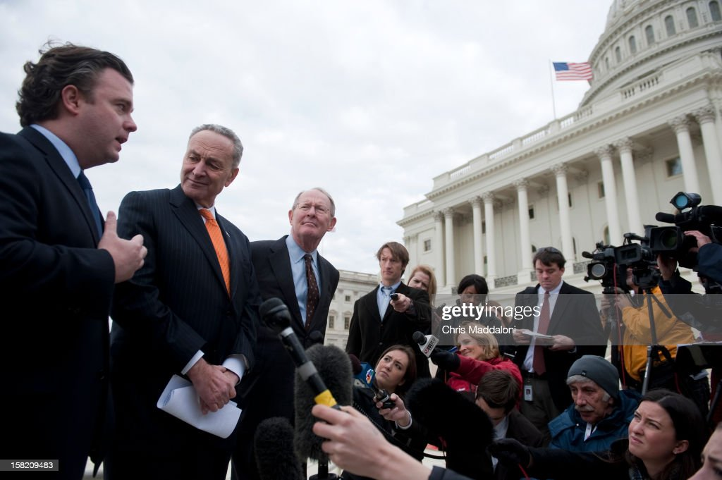 Presidential Inaugural Committee CEO Steve Kerrigan, Sen. Chuck Schumer, D-N.Y.; and Sen. Lamar Alexander, R-Tenn., show the press the finishing touches of the stands at the U.S. Capitol for President Barack Obama's Inauguration on January 21, 2013.