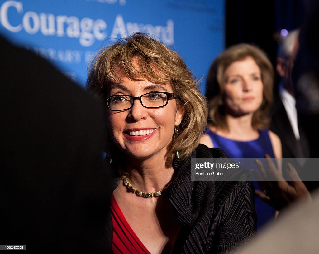 JFK Presidential Library - Former Arizona Congresswoman and co-founder of Americans for Responsible Solutions Gabrielle Giffords, left, was honored by Caroline Kennedy, right, President of the Kennedy Library Foundation, with the 2013 John F. Kennedy Profile in Courage Award on May 5, 2013 at the JFK Presidential Library. Giffords was accompanied by her husband, Captain Mark Kelly (US Navy - Ret.), co-founder of Americans for Responsible Solutions. The JFK Profile in Courage Award is presented annually to public servants who have made courageous decisions of conscience without regard for the personal or professional consequences.