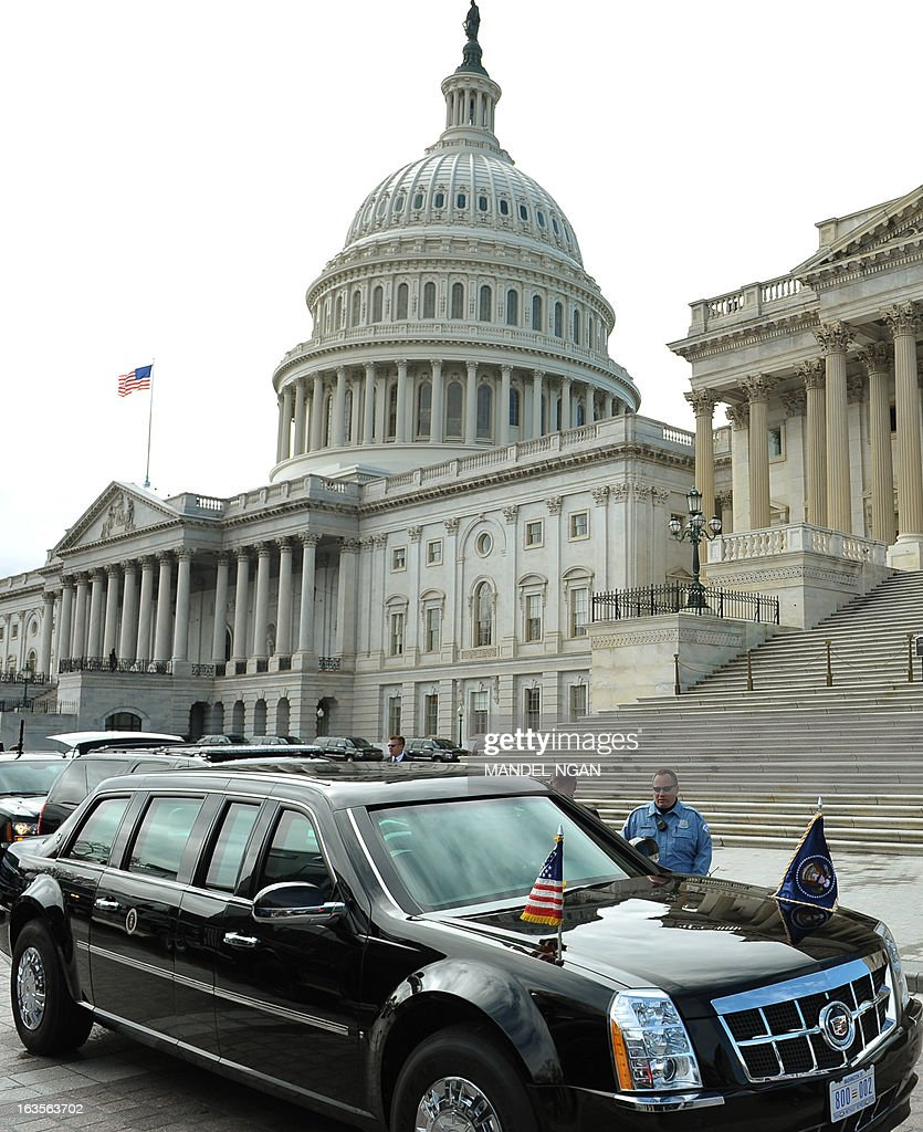 A presidential limousine is seen infront of the US Capitol as US President Barack Obama meets with the Senate Democratic Caucus on March 12, 2013 in Washington, DC. AFP PHOTO/Mandel NGAN