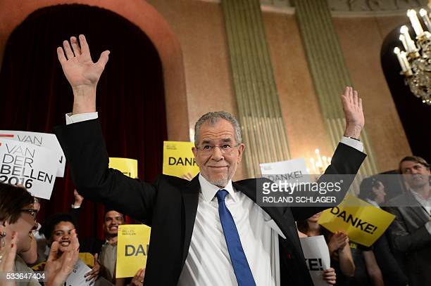 Presidentianl candidate backed by the Greens Alexander Van der Bellen reacts during an election party after the second round of the Austrian...