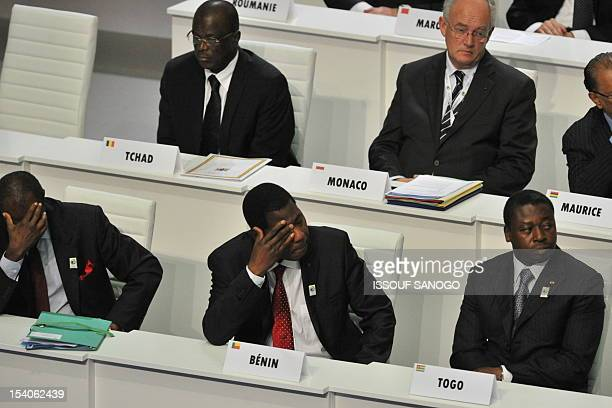 Presidents Alpha Conde of Guinea Thomas Boni Yayi of Benin and Faure Gnassingbe of Togo attend the opening of the Frenchspeaking nations...
