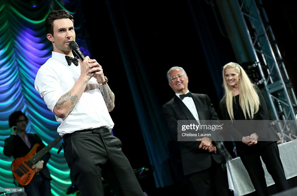 President's Award recipient <a gi-track='captionPersonalityLinkClicked' href=/galleries/search?phrase=Adam+Levine+-+Chanteur&family=editorial&specificpeople=202962 ng-click='$event.stopPropagation()'>Adam Levine</a> onstage with BMI President & CEO <a gi-track='captionPersonalityLinkClicked' href=/galleries/search?phrase=Del+Bryant&family=editorial&specificpeople=239201 ng-click='$event.stopPropagation()'>Del Bryant</a> and BMI Vice President & General Manager, Writer/Publisher Relations Barbara Cane at the 2013 BMI Pop Awards at the Beverly Wilshire Four Seasons Hotel on May 14, 2013 in Beverly Hills, California.