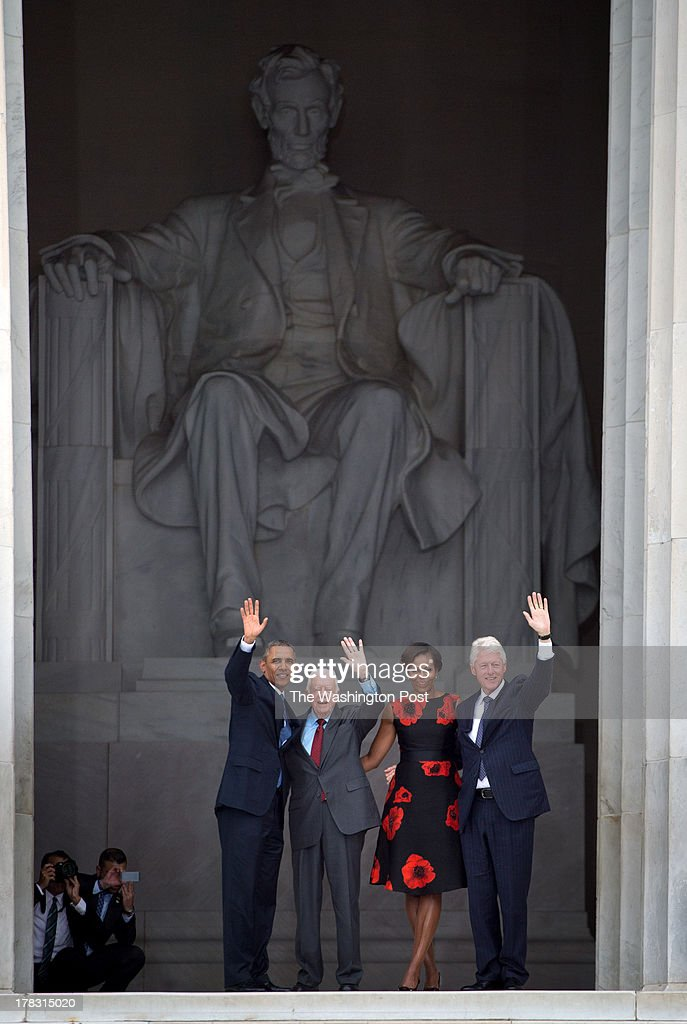 Presidents Barack Obama, Jimmy Carter, First Lady Michelle Obama and President Bill Clinton wave as the 50th Anniversary March on Washington wraps up at the Lincoln Memorial in Washington, D.C., on Wednesday, August 28, 2013.