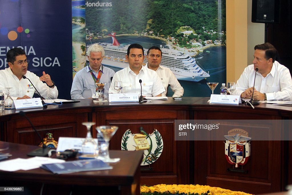 Presidents Juan Orlando Hernandez of Honduras, Jimmy Morales of Guatemala and Juan Carlos Varela of Panama take part in the XLVII Ordinary Meeting of the chiefs of state members of the Central American Integration System (SICA) in Roatan island, Honduras, on June 30, 2016. Belize, Costa Rica, El Salvador, Guatemala, Honduras, Nicaragua, Panama and Dominican Republic are members of the SICA. / AFP / STR