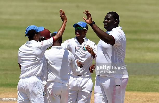 President's XI squad cricketer Rahkeem Cornwall celebrates with teammates after dismissing Indian batsman Stuart Binny during Day 2 of the threeday...