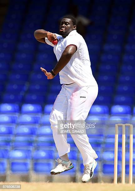 President's XI squad cricketer Rahkeem Cornwall delivers a ball during Day 2 of the threeday tour match between India and WICB President's XI squad...