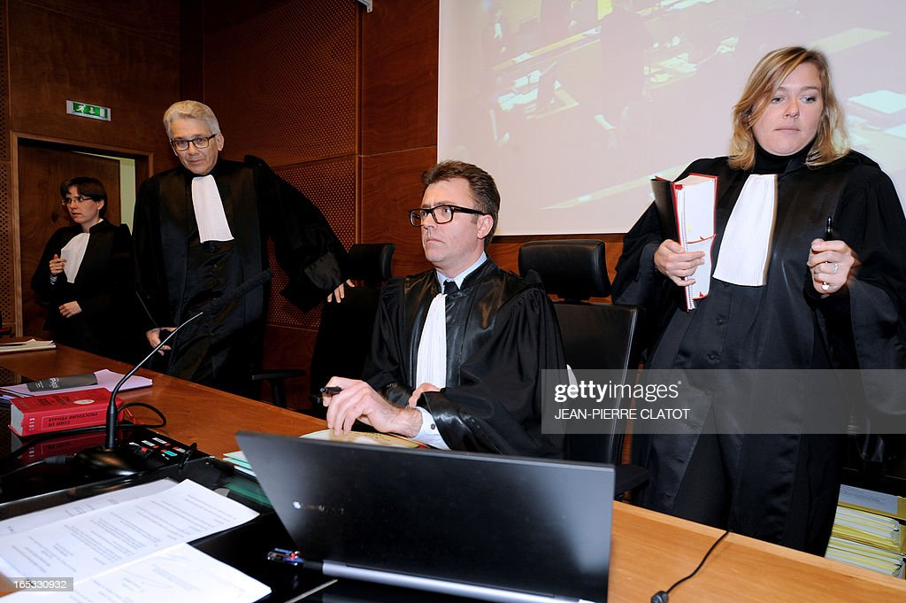 Presiding Judge Benjamin Deparis (C) sits on April 3, 2013 during a recess in the courthouse of the Alpine city of Thonon-les-Bains after the opening of the trial into the June 2, 2008 collision of a school bus and a train at a railway crossing in the eastern French town of Allinges. School bus driver Jean-Jacques Prost, the state-owned railway company SNCF and rail operator Reseau Ferre de France are charged with involuntary homicides after a train hit the school bus carrying teenagers, killing seven students and wounding 25. One of the teachers, who survived the crash, later committed suicide.