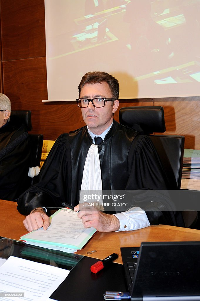 Presiding Judge Benjamin Deparis sits on April 3, 2013 during a recess in the courthouse of the Alpine city of Thonon-les-Bains after the opening of the trial into the June 2, 2008 collision of a school bus and a train at a railway crossing in the eastern French town of Allinges. School bus driver Jean-Jacques Prost, the state-owned railway company SNCF and rail operator Reseau Ferre de France are charged with involuntary homicides after a train hit the school bus carrying teenagers, killing seven students and wounding 25. One of the teachers, who survived the crash, later committed suicide.