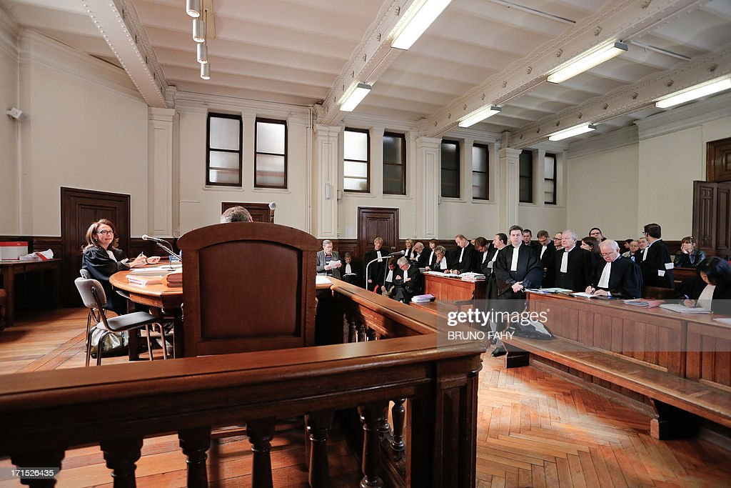Presiding Judge Manuella Cadelli (L) sits on June 26, 2013 during the first day of a trial of 49 people involved in the so-called Namur casino case and charged with forgery, active corruption, misuse of public funds, breach of trust and tax fraud between 1983 and 2004 in the Namur criminal court. The fraud is estimated to amount to between 50 and 75 millions euros and the center figure of the case is former head of the Namur casino, Armand Khaida. OUT -