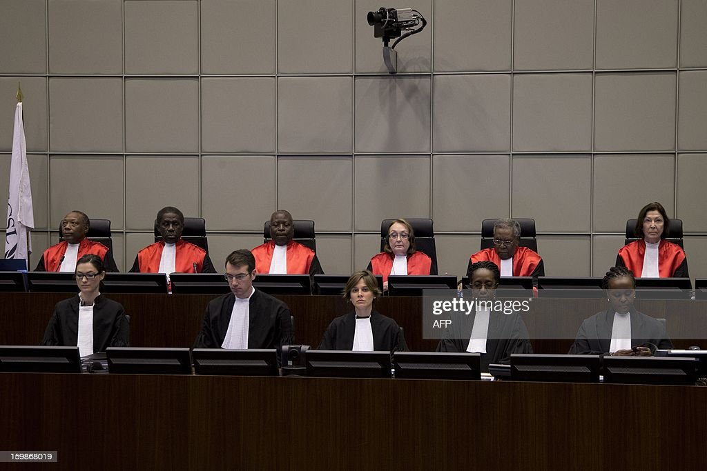 Presiding Judge Shireen Fisher (top, 3rd R) and other unidentified judges wait on January 22, 2013 for the start of the appeal hearing of former Liberian President Charles Taylor before Sierra Leone's UN-backed special court in Leidschendam, The Netherlands. The former Liberian warlord began his appeal at the Special Court for Sierre Leone's against his 50-year prison sentence for fuelling the west African nation's savage civil war. Appeals judges are to hear arguments from prosecutors demanding a heavier sentence and from the former strongman's lawyers calling for his 50-year sentence to be quashed or reduced. Judges said he aided and abetted rebel forces fighting against Freetown during Sierra Leone's 10-year civil war, known for its mutilations, drugged child soldiers and sex slaves. AFP PHOTO / POOL / PETER DEJONG - netherlands out -