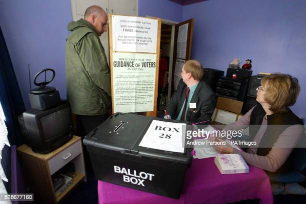 Presiding Officer Phil Lenny and Poll Clerk Caroline Bishop watch over a Polling Station set up in Chettisham Cambridgeshire in the bedroom of a...