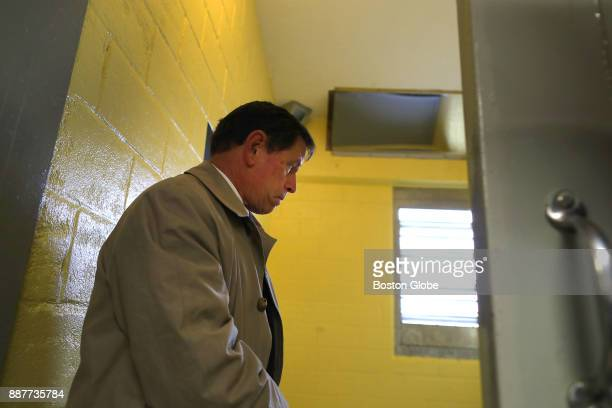 Presiding Plymouth Superior Court Judge Jeffrey Locke looks into Cell 13 at the Bridgewater State Hospital in Bridgewater MA on Dec 6 as a visit to...