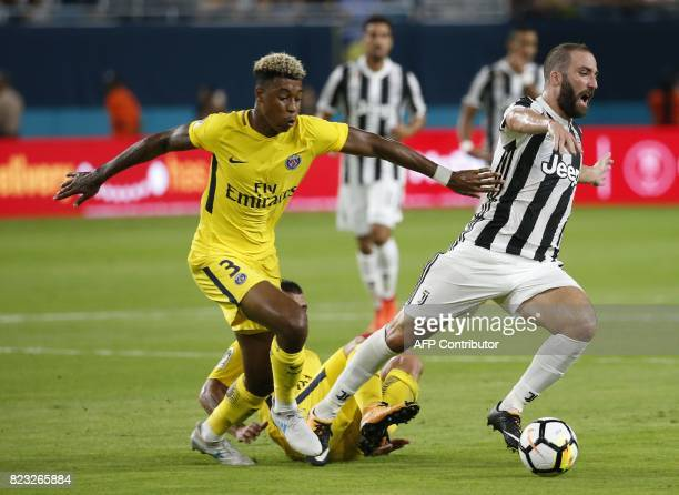 Presnel Kimpembe of Paris SaintGermain and Gonzalo Higuain of Juventus during their International Champions Cup football match on July 26 2017 at the...