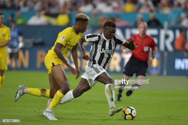Presnel Kimpembe of Paris SaintGermain and Moise Kean of Juventus vie for the ball during their International Champions Cup football match on July 26...