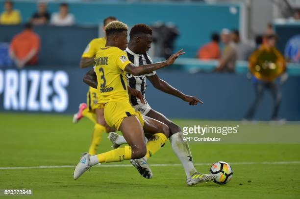 Presnel Kimpembe of Paris SaintGermain causes a penalty against Moise Kean of Juventus during their International Champions Cup football match on...