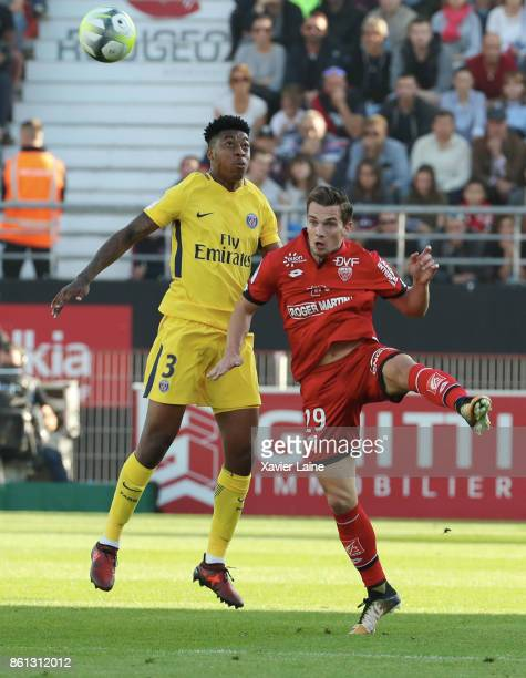 Presnel Kimpembe of Paris SaintGermain in action Benjamin Jeannot of Dijon FCO during the Ligue 1 match between Dijon FCO and Paris Saint Germain at...