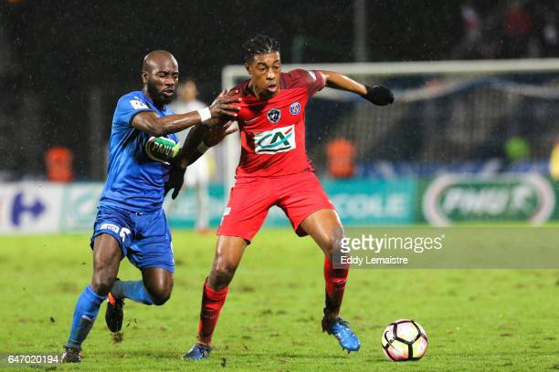 Presnel Kimpembe of PSG and Alliou Dembele of Niort during the French Cup match between Niort and Paris Saint Germain on March 1 2017 in Niort France
