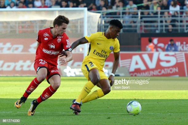 Presnel Kimpembe of PSG and Benjamin Jeannot of Dijon during the Ligue 1 match between Dijon FCO and Paris Saint Germain at Stade Gaston Gerard on...
