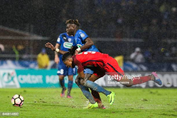 Presnel Kimpembe of PSG and Junior Sambia of Niort during the French Cup match between Niort and Paris Saint Germain on March 1 2017 in Niort France