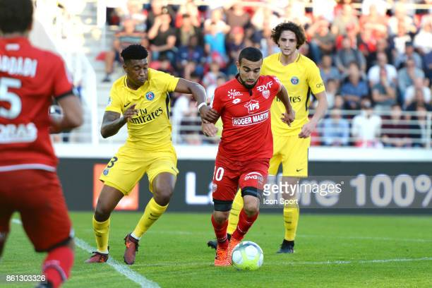 Presnel Kimpembe of PSG and Naim Sliti of Dijon during the Ligue 1 match between Dijon FCO and Paris Saint Germain at Stade Gaston Gerard on October...