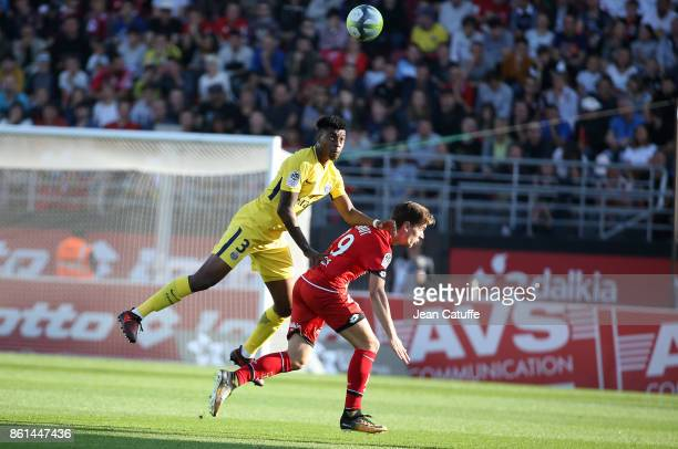 Presnel Kimpembe of PSG Benjamin Jeannot of Dijon during the French Ligue 1 match between Dijon FCO and Paris Saint Germain at Stade Gaston Gerard on...