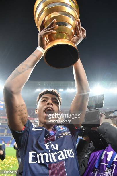 Presnel Kimpembe poses with the trophy after winning the French League Cup final football match between AS Monaco and Paris SaintGermain at the Stade...