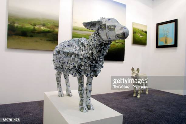 Press and artists view 'EU Ewe' made with wire plaster paper and real Euro currency by artist Justine Smith on sale for 4 on the preview day of ART...