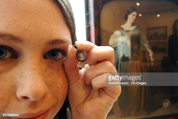 Press Assistant Holly Nuttall holds the smallest miniature portrait in the world of Scandinavian School circa of 1680 ' A gentleman wearing a scarlet...