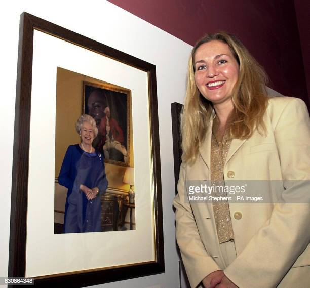 Press Association photographer Fiona Hanson at the National Portrait Gallery London to see her portrait of Queen Elizabeth II before it goes on...