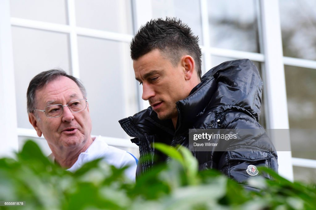 Press attache Philippe Tournon and Laurent Koscielny of France arriving at Centre National du Football on March 20, 2017 in Clairefontaine, France.