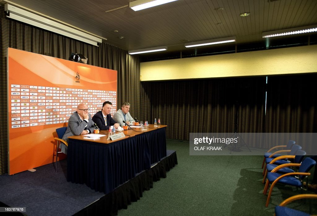 Press chief Kees Jansma, Dutch national football team coach Louis van Gaal and youth team coach Cor Pot give a press conference in Zeist on March 15, 2013. Van Gaal announced the selection of players for the 2014 World Cup qualifying match against Estonia on March 22. AFP PHOTO - ANP / OLAF KRAAK netherlands out